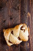 picture of phyllo dough  - Apple strudel on a wooden surface - JPG
