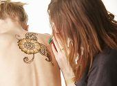 stock photo of mehndi  - Image of mehndi master drawing on naked model - JPG