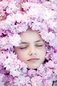 picture of pink eyes  - Face of small girl with closed eyes among pink flowers of japanese cherry blossom copyspase horizontal picture - JPG