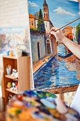 picture of masterpiece  - Hand of artist painting street of Venice on canvas - JPG