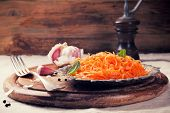 stock photo of korean  - Spicy Korean style carrot salad on metal plate with spices - JPG