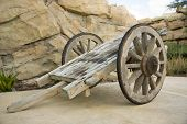 picture of wagon  - Wooden wagon carrier and stone wall around - JPG