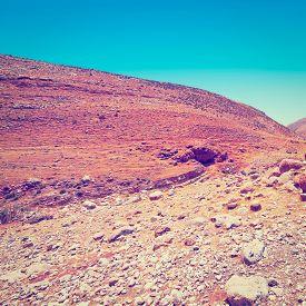 stock photo of samaria  - Big Stones in Sand Hills of Samaria Israel Retro Effect - JPG