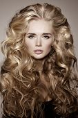 Постер, плакат: Model with blonde long hair Waves Curls Hairstyle Hair Salon Updo Fashion model with shiny hair