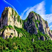 Montserrat mountains in Europe over beautiful cloudy sky poster