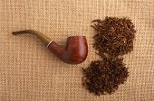 stock photo of peace-pipe  - pipe and tobacco on jute material extreme - JPG