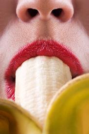 stock photo of fellatio  - Sex symbol women sucking eating banana fruit food - JPG