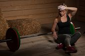Active Young Woman Sweep Sweat After Fitness Workout - Power Lifter Resting poster