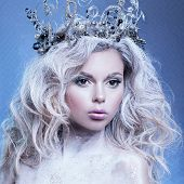 Beautiful Portrait Of A Young Girl. The Image Of A Snow Queen With A Crown On His Head.  New Year Th poster