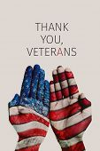 closeup of the hands of a man patterned with the flag of the United States and the text thank you ve poster