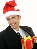 Businessman Wearing A Santa Hat And Holding A Gift poster