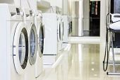 Washing machines, dryer and other domestic appliance equipment in the store poster