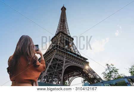 poster of Travelling In Europe, Traveler Woman Taking Photo Of Eiffel Tower, Famous Landmark And Travel Destin