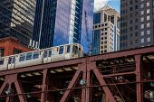 Chicago Train On A Bridge, Skyscrapers Background, Low Angle View poster