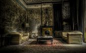 stock photo of derelict  - living room in an abandoned complex with intect interiors and mold all over the walls - JPG