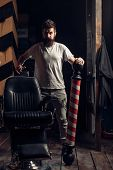 Beard Man Visiting Hairstylist In Barber Shop. Brutal Guy In Modern Barber Shop. Barber Shop. Portra poster