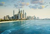 Dubai, Uae United Arabs Emirates. City Of Skyscrapers, Dubai Marina At Sunset. Front Line Beach Hote poster