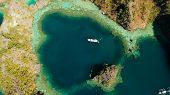 Aerial Drone Speed Boat With Tourists In Beautiful Lagoon. Tropical Landscape. Blue Lagoon Surrounde poster