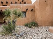 Pueblo Style Home Exterior. Adobe Style Building Exterior In The American Southwest  Desert With A S poster