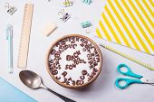 A Plate With A Quick Breakfast Of Chocolate Flakes In The Shape Of Letters From Which Is Laid Out Ba poster