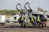 Aircraft Director And Pilots Alpha Jet Who Are Checking The Readiness To Fly.  The Alpha Jet Is A Hi poster