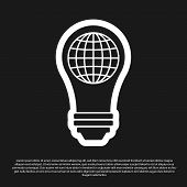 Black Light Bulb With Inside World Globe Icon Isolated On Black Background. Planet Earth On The Lamp poster