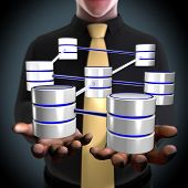stock photo of three tier  - Concept of an architect creating a database network - JPG