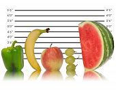 image of police lineup  - Unique creative image of fruit lined up against police ID line up - JPG