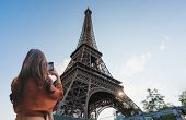 Travelling In Europe, Traveler Woman Taking Photo Of Eiffel Tower, Famous Landmark And Travel Destin poster