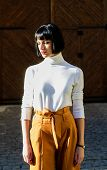Girl Makeup Face Wear Loose High Waisted Pants. High Waisted Trousers Keep Returning To Catwalk. Hig poster