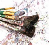 image of paint brush  - a collection of paint brushes on art paper