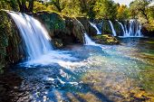 Magnificent cascade of waterfalls on the river Sluncica. The small Croatian town of Slunj. Beautiful poster