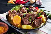 Traditional Jamaican Curry Goat - Slow Cooked Jamaican Goat Meat And Vegetables Spicy Curry In A Bla poster