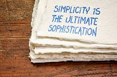 Simplicity is the ultimate sophistication - inspirational handwriting on a handmade rag paper poster