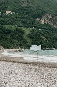 View Of The Turbulent Sea In Windy Weather Or Strong Wind. White Flags Indicate That The Wind Is Str poster