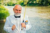 Fly Fishing For Trout. Brown Trout Being Caught In Fishing Net. Portrait Of Cheerful Man Fishing. Fl poster