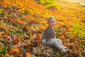 Happy Childhood. Sweet Childhood Memories. Child Autumn Leaves Background. Warm Moments Of Autumn. T poster