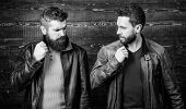 Men Brutal Bearded Hipster Posing In Fashionable Black Leather Jackets. Handsome Stylish And Cool. F poster