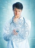 Young Pensive Medical Doctor Touching A Virtual Padlock In A Virtual Security Mechanism. Information poster