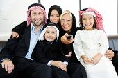 pic of muslim kids  - Arabic Muslim family father and mother with children watching television - JPG