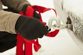 image of pick-lock  - Man keep towing rope with hook near car - JPG