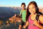 Couple hikers in Grand Canyon. Aspirational lifestyle image of happy young people hiking the South R