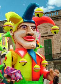 pic of mardi gras mask  - jester float in carnival parade - JPG