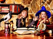 stock photo of witch ball  - Witch  children with crystal ball - JPG