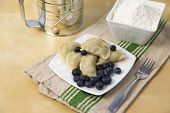 pic of flour sifter  - small plate full of Polish pierogi with blueberry filling - JPG