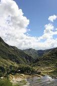 pic of ifugao  - clouds towering in blue sky reflected in the ancient rice terraces of batad in northern luzon the philippines - JPG