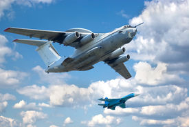 image of awacs  - Two planes fly in formation against the picturesque sky. A-50 (base IL-76) and Su-27 (Flanker). ** Note: Slight blurriness, best at smaller sizes - JPG