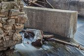 a detail of old river diversion dam - Cache la Poudre River, Fort Collins, Colorado