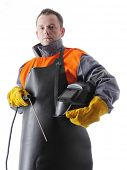 stock photo of welding  - Portrait of welder wearing protective welding black leather apron - JPG