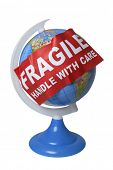 Globe covered by sign with Fragile Handle With Care